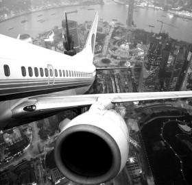 airplane take off over shanghai, china