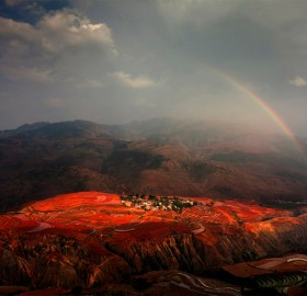 rainbow over red land, china