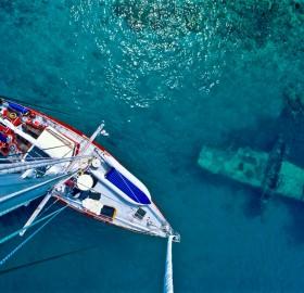 yacht passes sunken WW2 plane