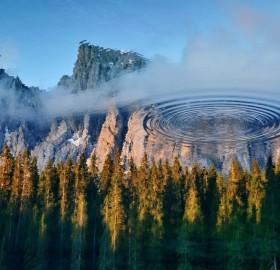 reflections in carezza lake, italy