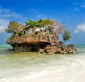 small fish restaurant on rock at sea, zanzibar