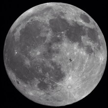international space station passing the moon