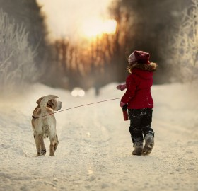 little girl and her dog, winter walk