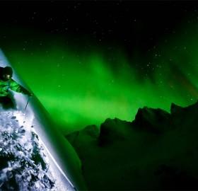 skiing under aurora borealis