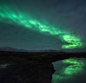 aurora borealis behind clouds