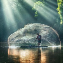 fisherman throwing his net photo