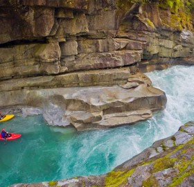 kayakers in ashlu creek, canada