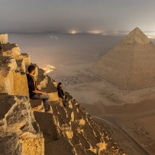 sitting on the pyramid, egypt