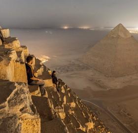 sitting on the pyramid, egypt