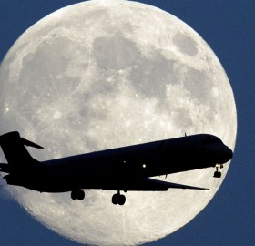 moon behind airplane