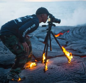 photographer without limits. taking a photo on lava