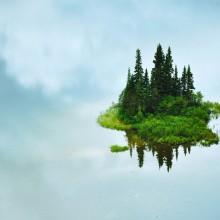 reflection of small island, tumuch lake