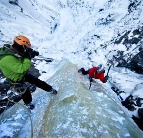 Free Climbing At Ice Waterfall