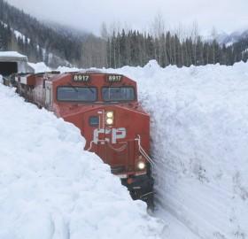 Train Rumbling Through Snow Banks, Canada