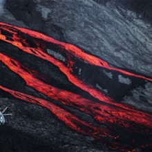 Helicopter Flies Over Lava Flows