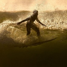 Surfer Rides A Wave, Spain